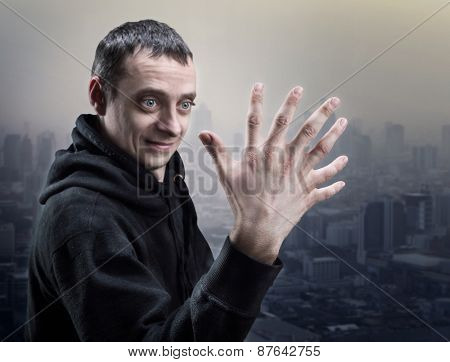 Surprised man looks at his strange hand