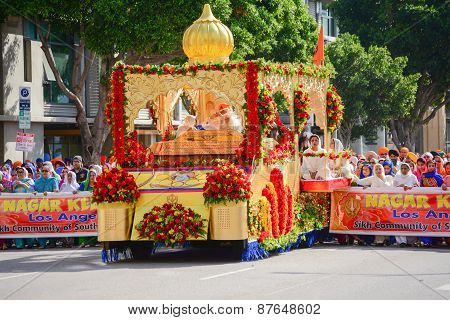Devotee Sikhs Marching Behind A Float