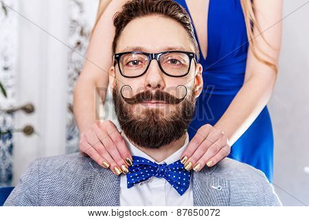 Old-fashioned Man With A Beard And Curled Mustache