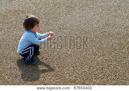Boy Playing With Rock