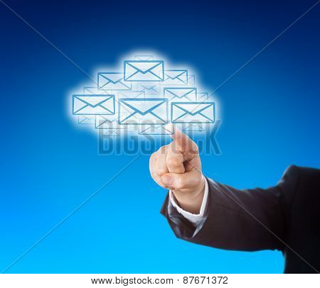 Corporate Arm Reaching Into Cloud Swarm Of Emails