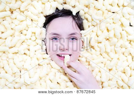 Little Girl With Blue Eyes In Corn Sticks