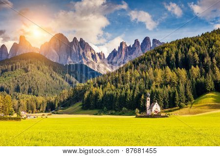 Countryside view of the valley Santa Maddalena in the National park Puez Odle or Geisler (Val di Funes). Dolomites, South Tyrol. Location Bolzano, Italy, Europe. Dramatic unusual scene. Beauty world.
