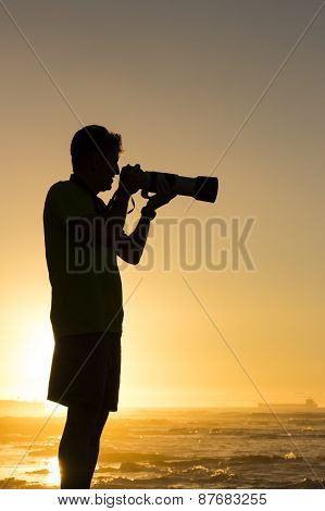 Silhouetted Travel Photographer