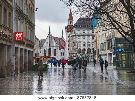 A central street in Munich on rainy cold winter day