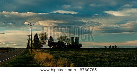 Farmhouse At Sunset