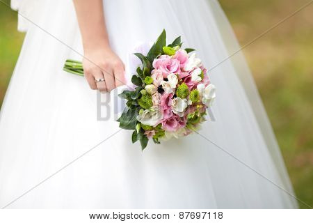 The Bride With A Wedding Bouquet