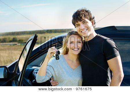 Happy Couple Near New Car