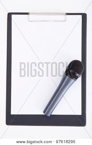 Speech Concept - Microphone And Clipboard With Blank Paper