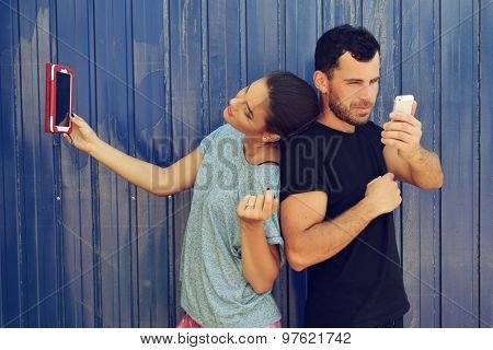 Young couple taking self photo with smartphone. Selfie, social networks, love, friendship, young adult, leisure concept.