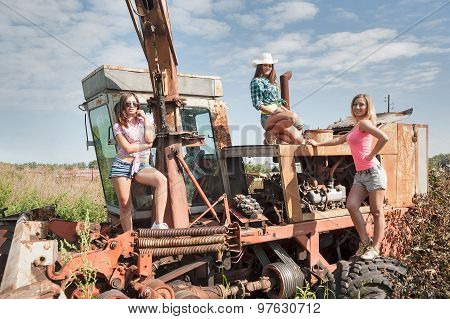 Beautiful women on old harvester