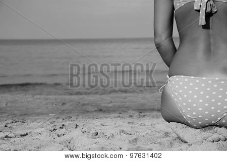 Good Looking Woman On Beach Sitting