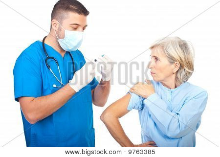 Doctor Man Preparing Syringe For Vaccination
