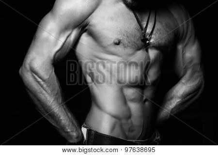 Muscular and sexy torso of young man with perfect abs. Black and white poster