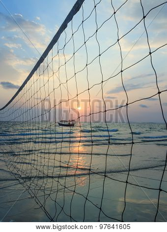 Sillhouette Of A Volleyball Net Against Sunset On The Beach