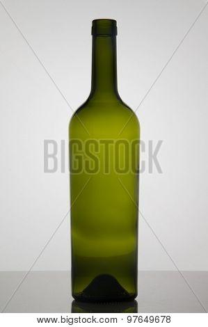Empty bottle of wine on white background