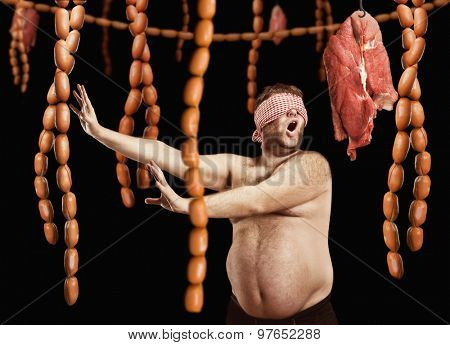 Fat man looking for sausages
