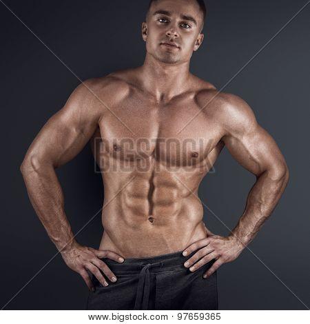 Muscular Man In Dark Background