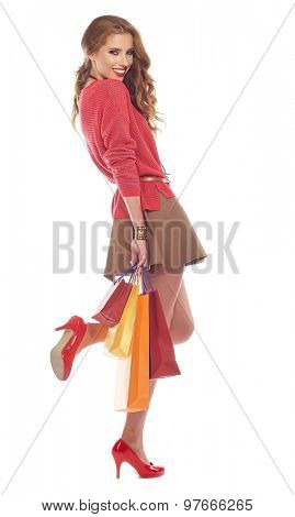 woman with shoping bags. Studio shoot