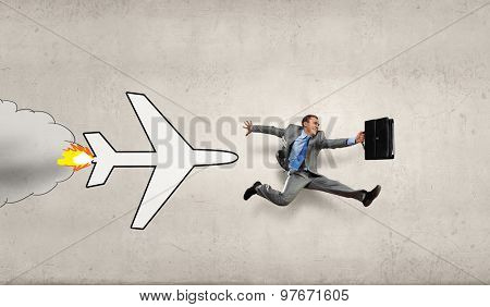Overworked young businessman being late on airplane