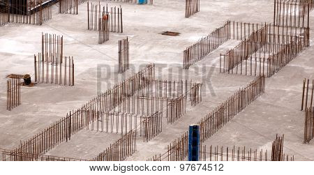 Construction of the building. Construction of an apartment house. Concrete slab foundation building. The foundation of reinforced concrete multistory apartment building. Release reinforcement for the walls. Stages of construction of the building. poster