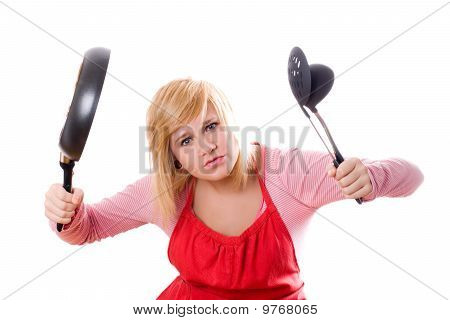 Pretty Housewife With Kitchen Utensil And Pan