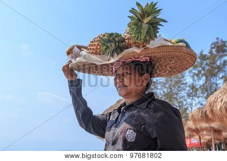 Unidentified Woman Selling Fruit At The Shoreline