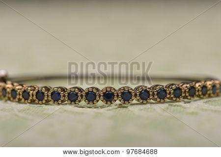 Bracelet Against Green Background
