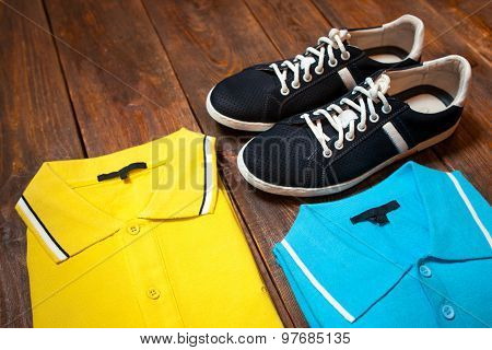 Set Of Colorful Men's T-shirts And Sport Shoes