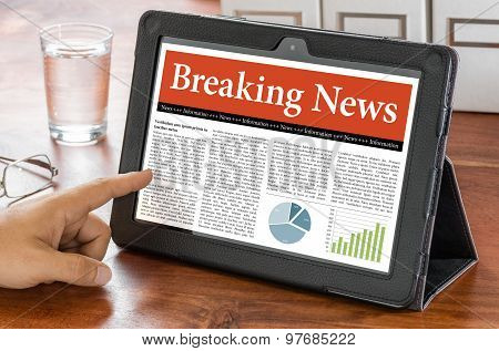 A Tablet Computer On A Desk - Breaking News