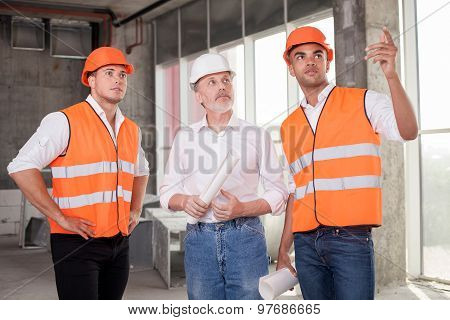 Skilled construction team is discussing a new project