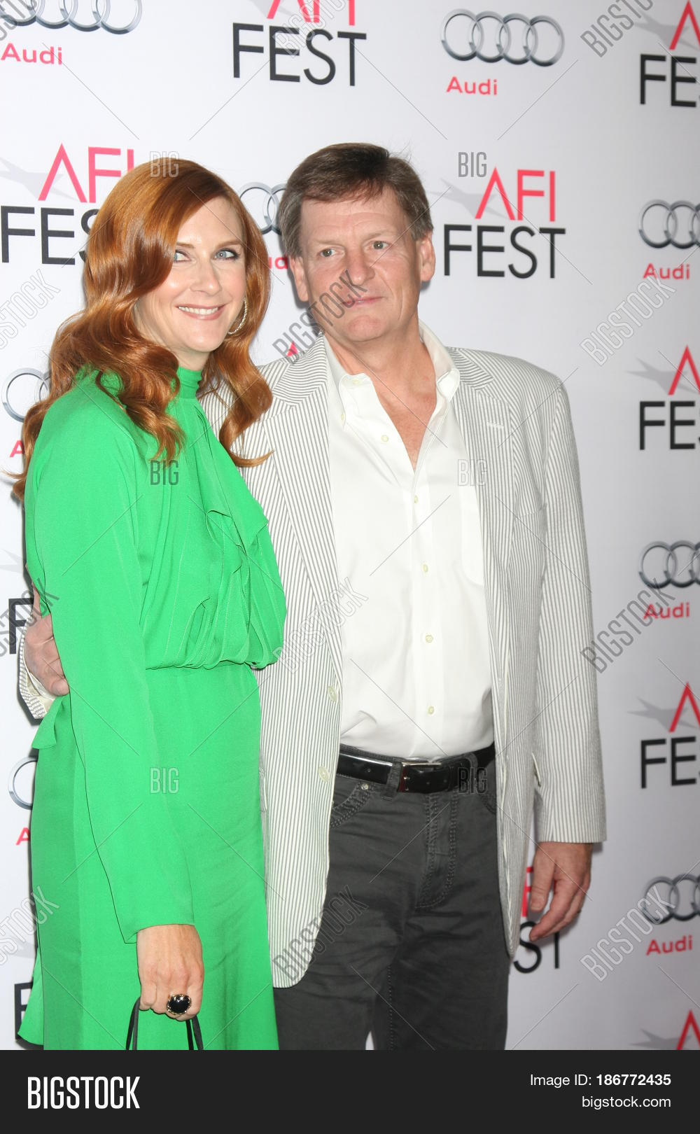 Michael Lewis with relaxed, Wife Tabitha Soren