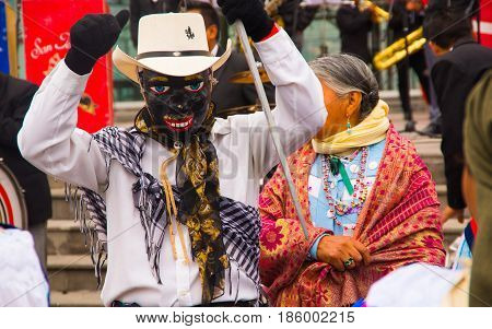Quito, Ecuador - December 09, 2016: An unidentified man using a black mask suring a parade in Quito, Ecuador.