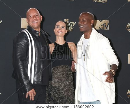LOS ANGELES - MAY 7:  Vin DIesel, Jordana Brewster, Tyrese Gibson at the MTV Movie and Television Awards on the Shrine Auditorium on May 7, 2017 in Los Angeles, CA