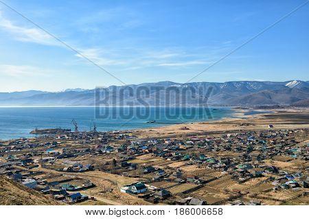 Southern shore of Lake Baikal Khamar-Daban Range and village Kultuk. Irkutsk region. Russia
