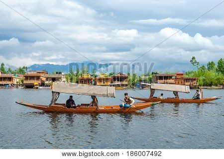 Srinagar India - April 23 2017 : Lifestyle in Dal lake People using small boat 'Shikara' for transportation