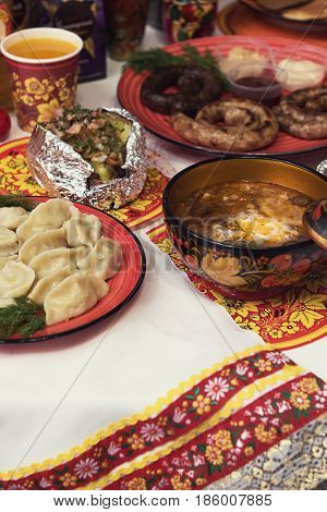Table with traditional russian food decorated in russian style