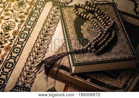 prayer beads on Koran ( holy book of Muslims )