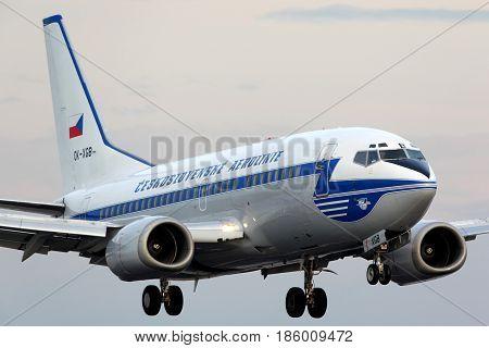 PRAGUE, CZECH REPUBLIC - NOVEMBER 2, 2012: Czech airlines Boeing 737-500 OK-XGB in retro color scheme landing at Ruzyne international airport.