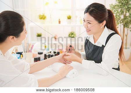 Women Enjoy Manicure And Talking