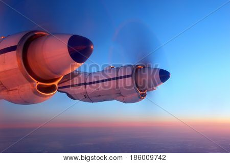 IN FLIGHT, RUSSIA - MARCH 31, 2013: Kosmos Airlines Antonov An-12 RA-11025 wing view on AI-20 engines.