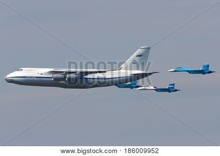 KHIMKI, MOSCOW REGION, RUSSIA - MAY 9, 2010: Antonov An-124 Ruslan and pair of Sukhoi Su-27 of Russian Air Force during Victory Day parade.