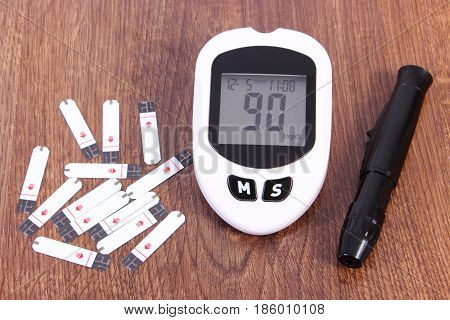 Glucose meter with good result sugar level and accessories for checking and measuring sugar level concept of diabetes and healthy lifestyles