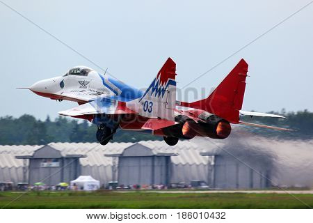 KUBINKA, MOSCOW REGION, RUSSIA - JUNE 13, 2011: Mikoyan MiG-29 03 BLUE jet fighter taking off at Kubinka air force base.