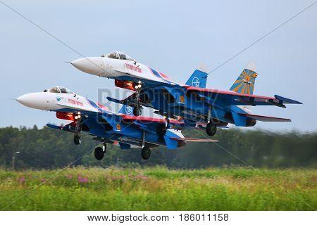 KUBINKA, MOSCOW REGION, RUSSIA - JUNE 3, 2011: Pair of Sukhoi Su-27 of Russian Knights aerobatics team jet fighters take off at Kubinka air force base.