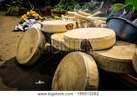 Cutting board made from wood with round shape on sale in traditional market photo taken in Bogor Indonesia java