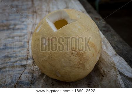 A peeled coconut with hole to take out the water photo taken in Bogor traditional market java