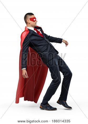 A businessman in a red superhero cape and a mask slipping and falling backwards. Business mistake. One-time slip. Failure and loss.
