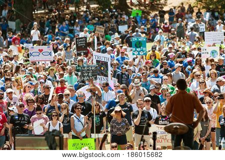 ATLANTA, GA - APRIL 22:  Thousands listen to a person speaking on the stage at Candler Park at a rally preceding the Atlanta March for Science in Atlanta GA on Earth Day on April 22 2017.