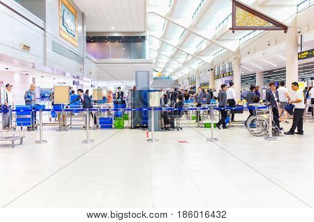 BANGKOK - JANUARY 14 2016 : Don Mueang airport security staff check passenger bags at gate on January 14 2016 in Don Mueang International Airport.